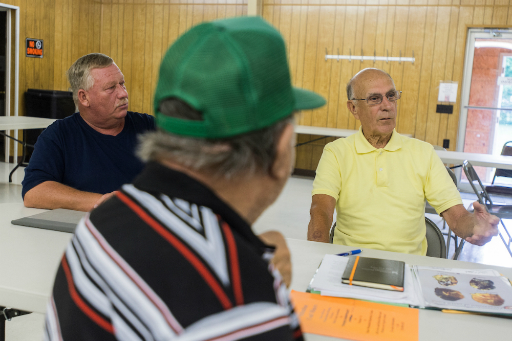 Brock talks to miners about black lung disease. Credit: Lathan Goumas for InsideClimate News