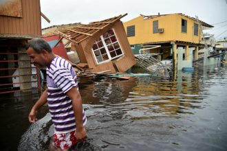 Flooding and wind from Hurricane Maria caused widespread damage in Puerto Rico. Credit: Hector Retamal/AFP/Getty Images
