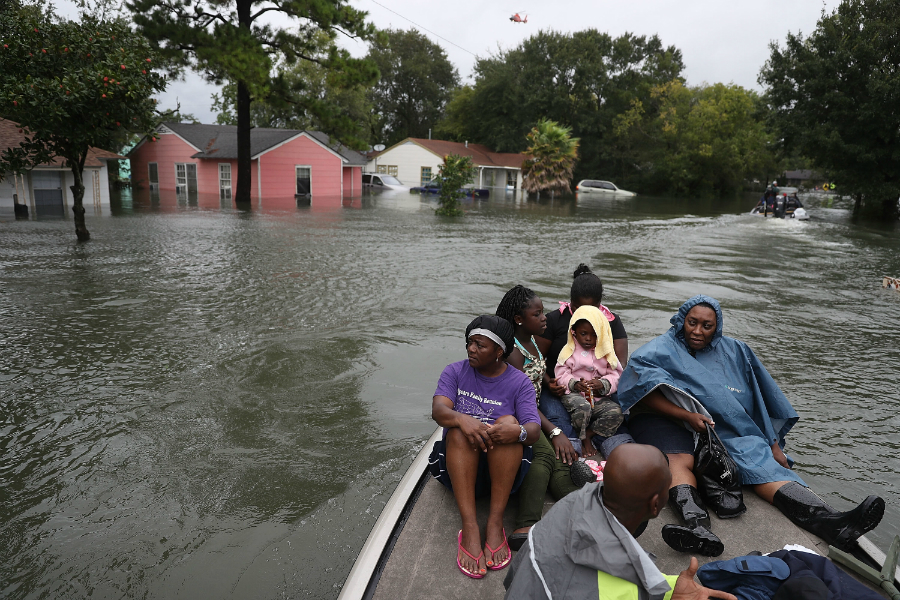 Neighborhoods in Port Arthur, Texas, flooded quickly as the remnants of Hurricane Harvey dumped 19 inches of rain on the city in late August. Credit: Joe Raedle/Getty Images