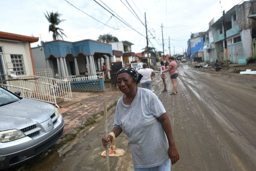 Hurricane Maria swept mud and debris down streets and into homes across the U.S. Territory of Puerto Rico. Credit: Hector Retamal/AFP/Getty Images