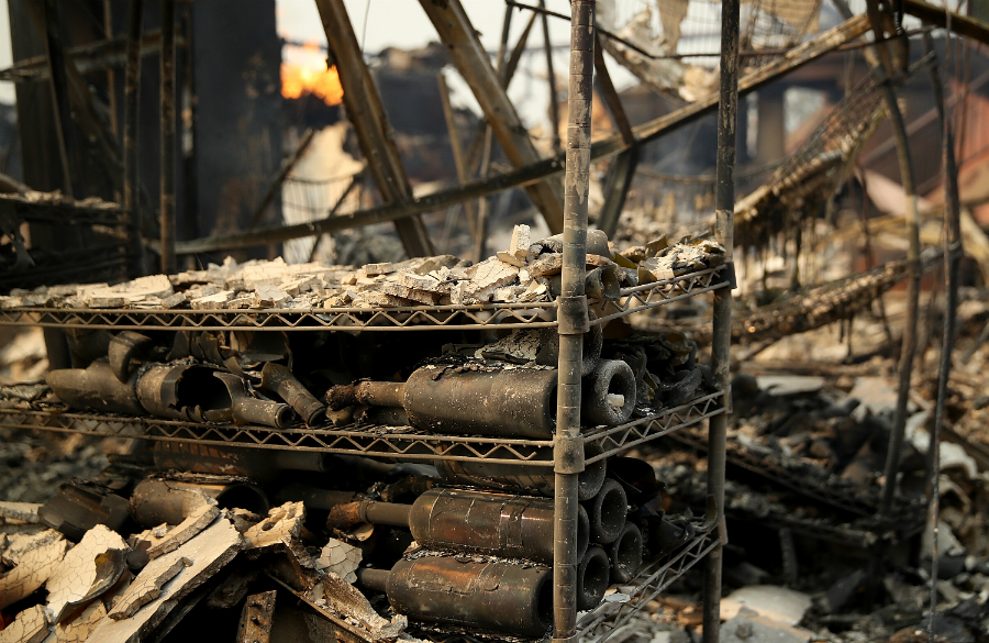 The Signarello Estate winery in Napa County was one of several wineries damaged by the flames. Tens of thousands of acres and hundreds of homes and businesses burned in the wind-blown wildfires. Credit: Justin Sullivan/Getty Images