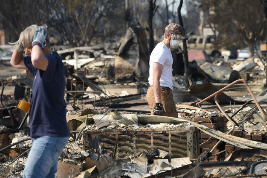 In Santa Rosa, residents returned on Oct. 11, 2017, to find entire neighborhoods reduced to ash by wind-blown fires that continued to menace the region. Credit: Robyn Beck/AFP/Getty Images