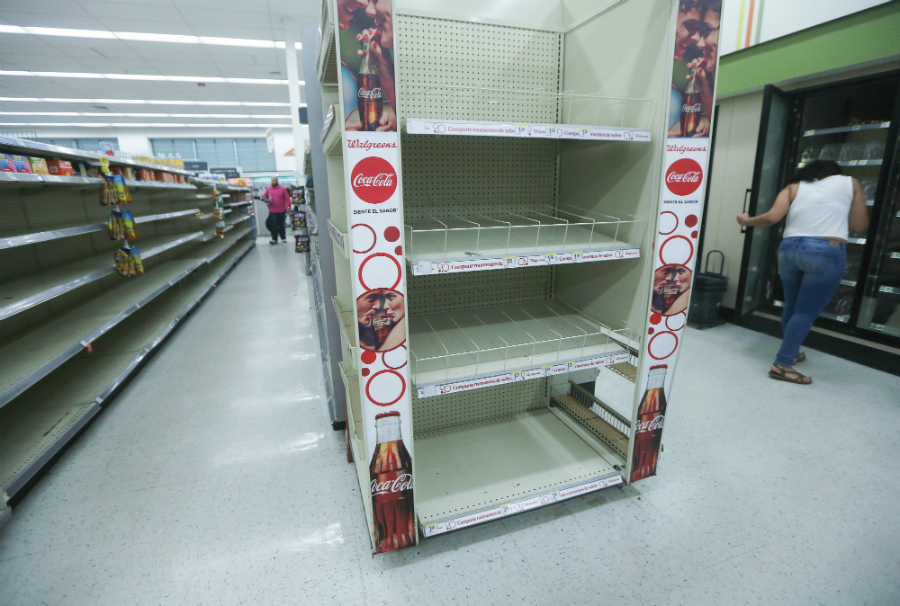 Beverage shelves in an open Walgreens in San Juan were mostly empty on Oct. 13, more than three weeks after the hurricane hit. Credit Mario Tama/Getty Images