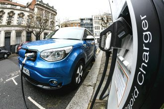 Electric car plugged in. Credit: Miles Willis/Getty Images