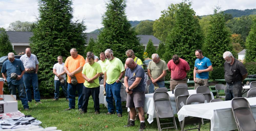 Town workers pray in White Sulphur Springs, West Virginia. Credit: Meera Subramanian
