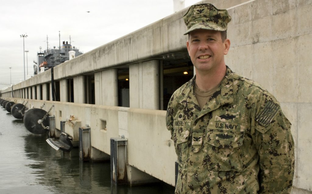 Capt. Dean VanderLey, head of engineering for much of the Navy's East Coast facilities, stands in front of one of four double-decker piers, which raise utility lines out of the flood zone.  Credit: Nicholas Kusnetz