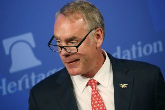 """Interior Secretary Ryan Zinke dismissed criticism of his travel expenses before delivering a speech about """"American Energy Dominance"""" at the Heritage Foundation on Sept. 29. Credit: Mark Wilson/Getty Images"""