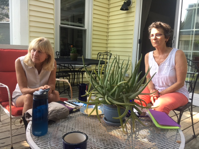 Judy Kline (left) and Roberta Zuckerman meet with other members of Protect South Portland who have been leading fundraising efforts to fight the pipeline plan. Credit: Sabrina Shankman