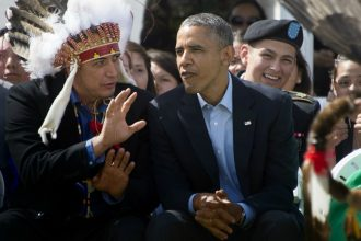 Standing Rock Souix Tribal Nation Chairman David Archambault II talks with President Obama during the Cannon Ball Flag Day Celebration in 2014. Credit: Jim Watson