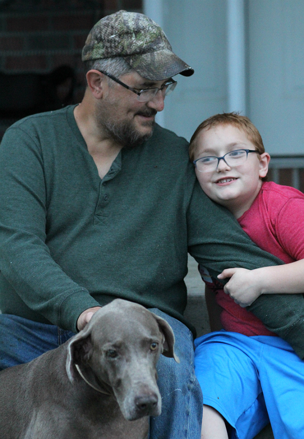 Brian Latkanich and his 7-year-old son, Ryan