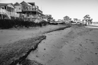In Nags Head, North Carolina, beach erosion and sea level rise is bringing the ocean underneath the remaining homes on East Seagull Drive. Credit: Weather Channel