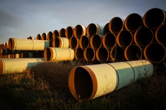 Miles of unused pipe, prepared for the proposed Keystone XL pipeline, sat outside Gascoyne, North Dakota, in 2014. Credit: Andrew Burton/Getty Images