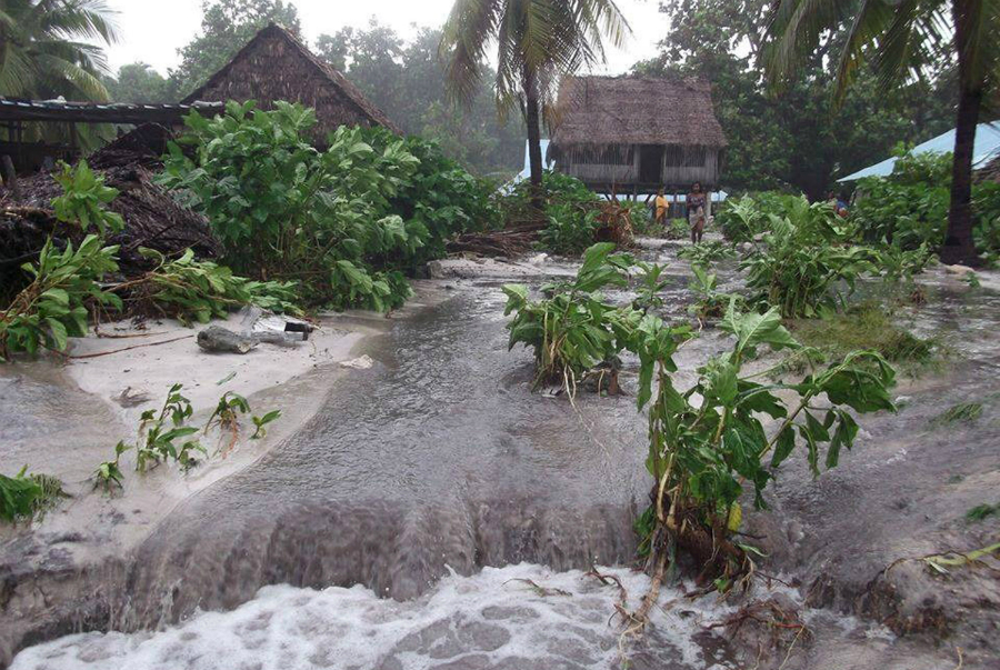 High tides and storm surges can inundate the islands of Kiribati, as waves from Cyclone Pam did in 2015, even though the cyclone was far from the islands. Credit: Plan International Australia via Getty Images