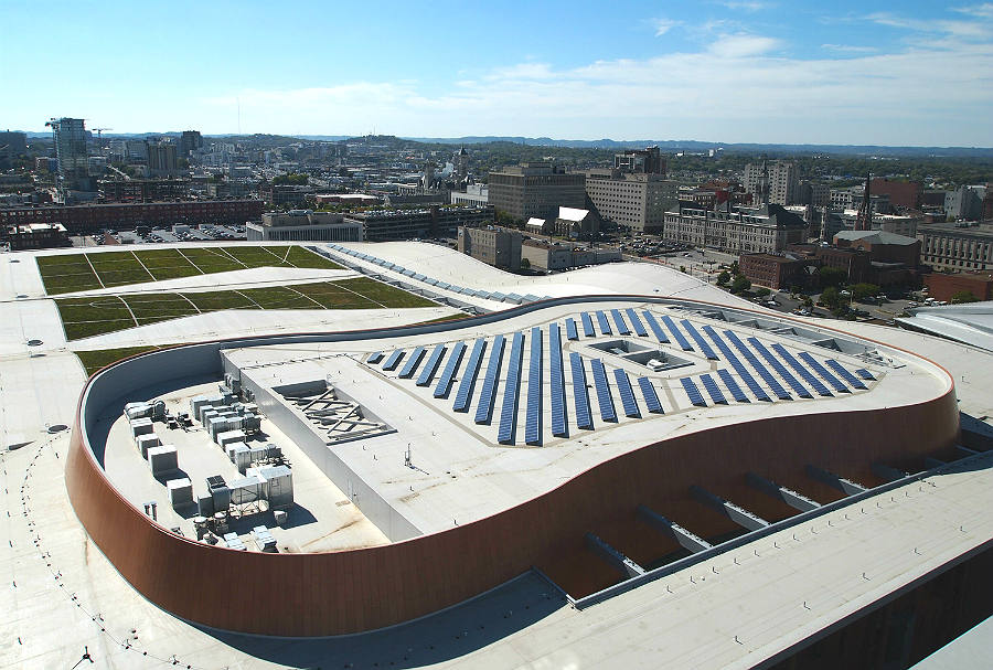 Planners of Nashville's Music City Center convention hall thought about sustainability when they installed a 211-kilowatt solar panel system in the shape of a guitar body on the center's green roof. But solar companies say protecting the climate isn't a s