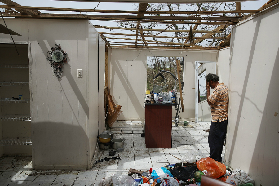 A man helps salvage what he can from his sister-in-law's home in Corzoal a week after the hurricane's winds and flooding. Credit: Joe Raedle/Getty images