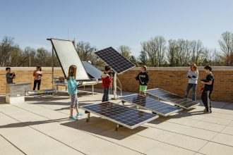 Students learn about different way solar energy can be harnessed in a rooftop lab at Discovery Elementary in Arlington, Virginia. The school has a 495-kilowatt solar array. Credit: Lincoln Barbour
