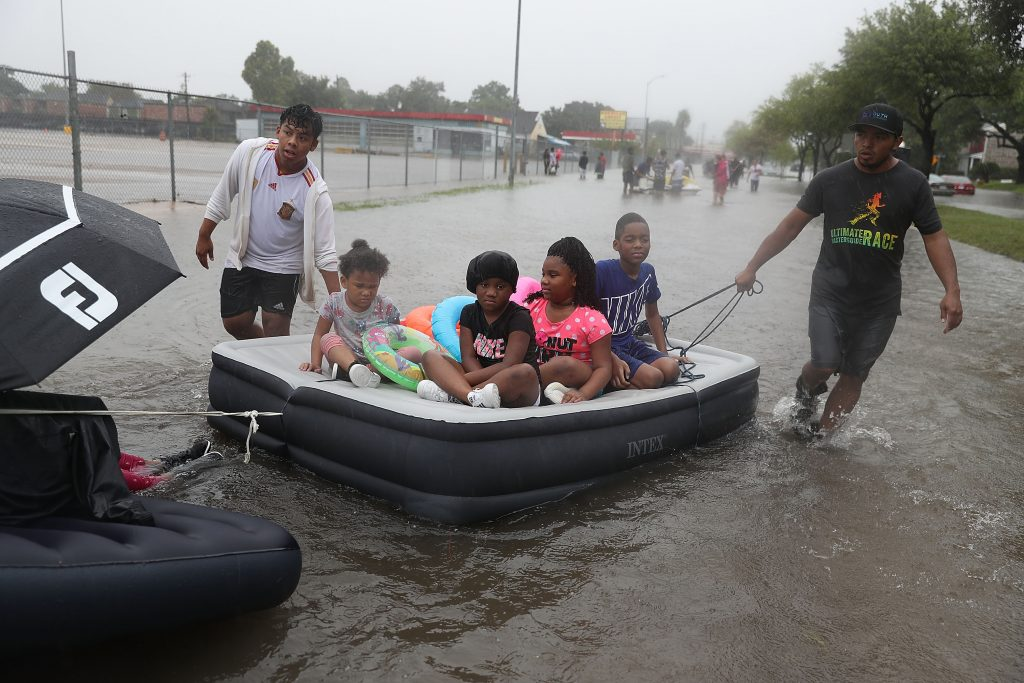 Heavy rain from Hurricane Harvey flooded neighborhoods across the Houston area. People used boats and anything that could float to make their way through the flooded streets to safety. Credit: Joe Raedle/Getty Images