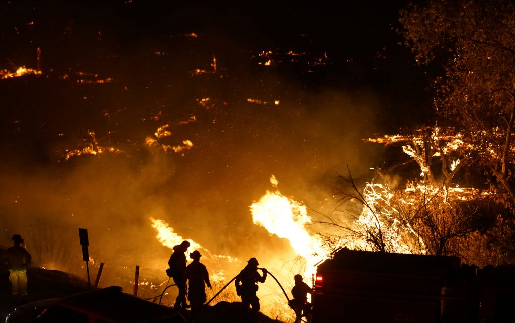 In December, what should have been a rainy period for Southern California became a new fire threat as the Santa Ana winds blew embers into dry hillsides, spreading out-of-control blazes. Credit: Sandy Huffaker/AFP/Getty Images
