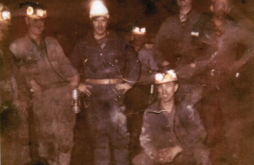 Bethel Brock (front) in the mines as a young man. Credit: Courtesy of Bethel Brock