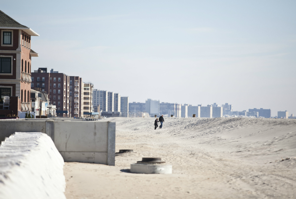 After Hurricane Sandy struck in 2012, new dunes were constructed to protect homes on Rockaway Beach in New York. Credit: Ramin Talaie/Getty Images