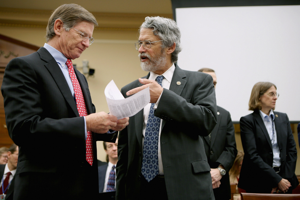 Rep. Lamar Smith, speaking here with John Holdren, director of the White House Office of Science and Technology Policy under President Barack Obama, strongly opposed the Obama administration's efforts to reduce power plant emissions. Credit: Chip Somodevi