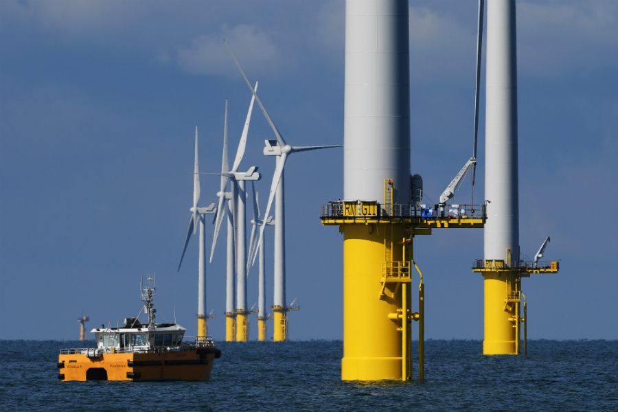 Offshore wind turbine maintenance crews often work in the same harsh conditions that offshore oil and gas rig staff are accustomed to. Credit: Mike Hewitt/Getty Images