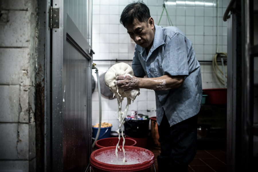 A man processes soy beans into soy milk to make traditional desserts in Hong Kong. Credit: Phillipe Lopez/AFP/Getty Images