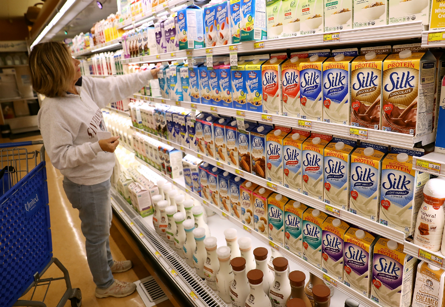 Almond, soy and other plant-based milks (even pea milk) have a smaller carbon footprint than cow's milk, and they're cutting into dairy's market share. Credit: Justin Sullivan/Getty Images