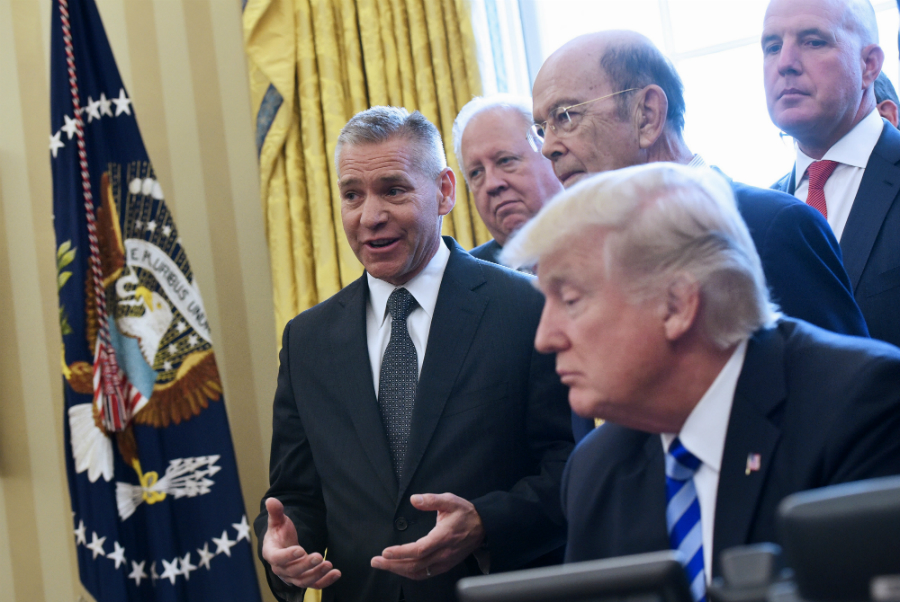 TransCanada CEO Russell Girling, left, was at the White House in March 2017 when President Donald Trump announced the final federal approval for the Keystone XL Pipeline. Credit: Mandel Ngan/AFP/Getty Images