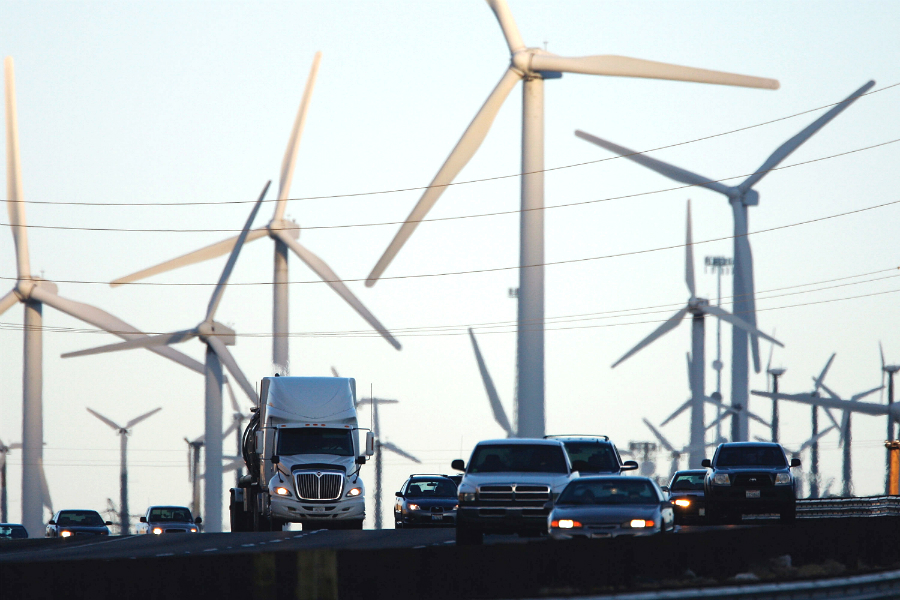 Among the recommendations for cutting greenhouse gas emissions quickly: boost renewable energy and expand the use of electric vehicles. Credit: David McNew/Getty Images