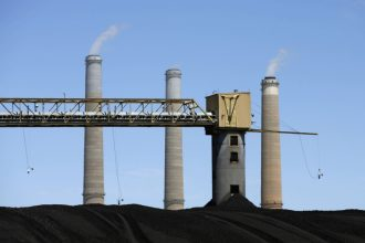 Coal piles sit outside the Hunter Power plant operated by PacifiCorp outside Castle Dale, Utah. The plan rejected by regulators would have paid coal-fired utilities extra to keep stock piles of coal on hand. Credit: George Frey/Getty Images