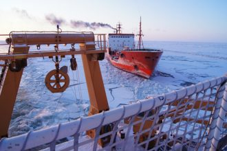 A ship plows through ice in the Bering Sea in January 2012. Credit: U.S. Coast Guard/Getty Images