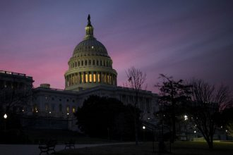 An early morning vote in Congress on a temporary spending bill ended a brief government shutdown. The bill also included tax credit extensions from some renewable energy technologies. Credit: Zach Gibson/Getty Images