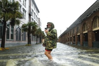 Charleston, South Carolina, shown here after Hurricane Matthew, is one of a few U.S. coastal cities to recently a adopt sea level rise strategy. Credit: Brian Blanco/Getty Images