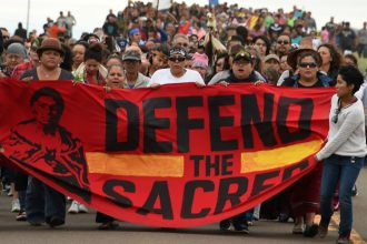 After seeing the treatment of the Dakota Access pipeline protesters, a group of Marathon investors filed a shareholder resolution that called on the oil company to explain how it weighs environmental and social risks. Credit: Robyn Beck/AFP/Getty Images