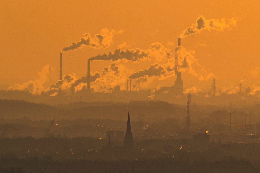 Smokestacks over an urban landscape. Credit: Lukas Schulze/Getty Images