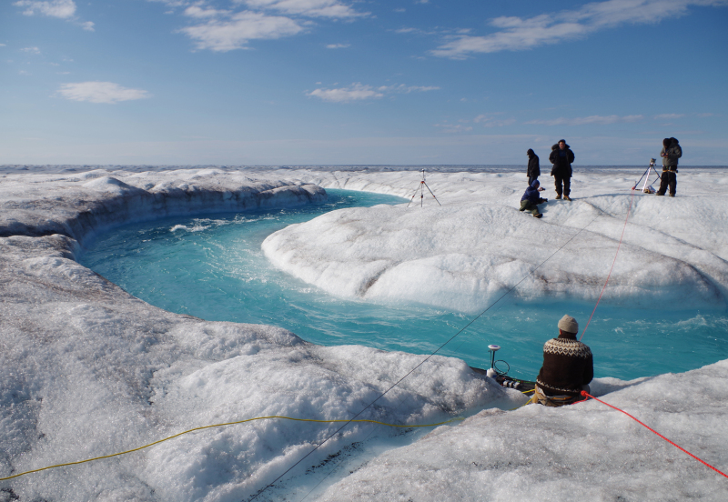 A UCLA research team takes measurements in Greenland, where soot has darkened the ice in some areas, contributing to melting. Credit: Mia Bennett/Cryopolitics