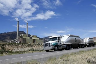 A coal truck leaves a power plant in Utah. Fossil fuel combustion in power plants and truck engines is a major producer of fine particulate matter linked to lung damage and other health problems. Credit: George Frey/Getty Images