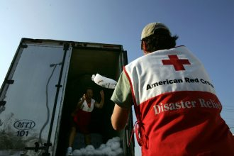 Red Cross volunteers deliver supplies after a hurricane. Credit: Spencer Platt/Getty Images