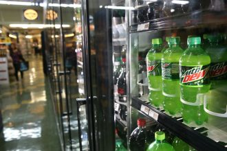 California now prohibits the use of HFCs, a potent greenhouse gas, in new refrigeration and cooling systems, including in grocery store refrigerator aisles like this one in San Francisco. Credit: Justin Sullivan/Getty Images