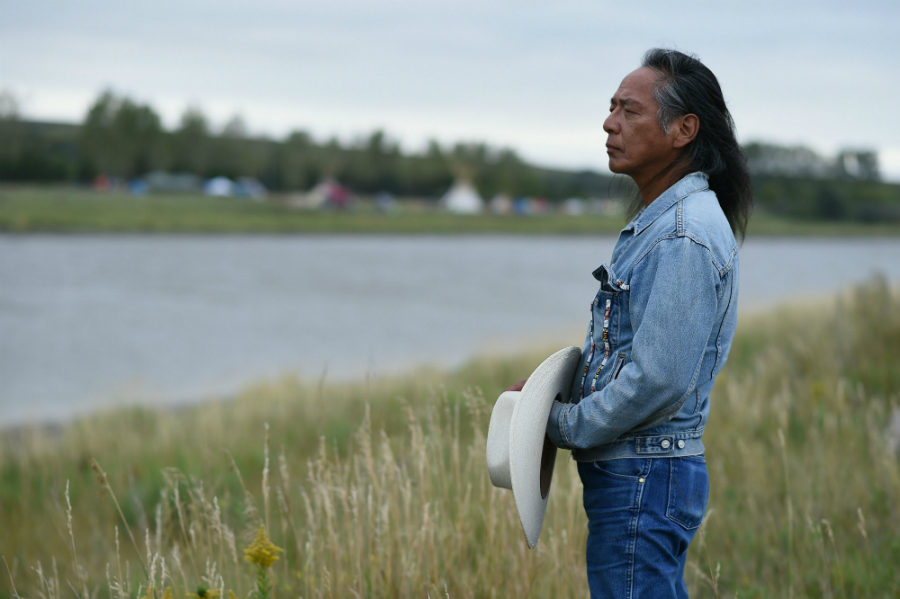 Ron His Horse Is Thunder, a Standing Rock Tribe spokesman, stands near the Dakota Access pipeline protest camp in 2016. Credit: Robyn Beck/AFP/Getty Images