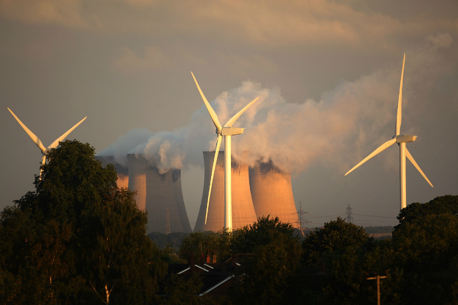 Wind turbines have been added near a coal-fired power station in the UK. Credit: Christopher Furlong/Getty Images