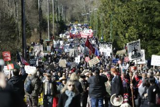 Protesters marched near the Kinder Morgan pipeline terminal in Burnaby, British Columbia, on March 18, 2018. Credit: Jason Redmond/AFP/Getty Images
