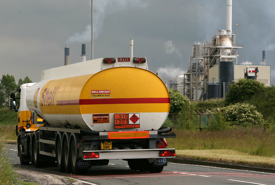 A Shell tanker truck leaves a refinery. New internal documents show the oil giant understood the climate risks from fossil fuels years ago. Credit: Christopher Furlong/Getty Images