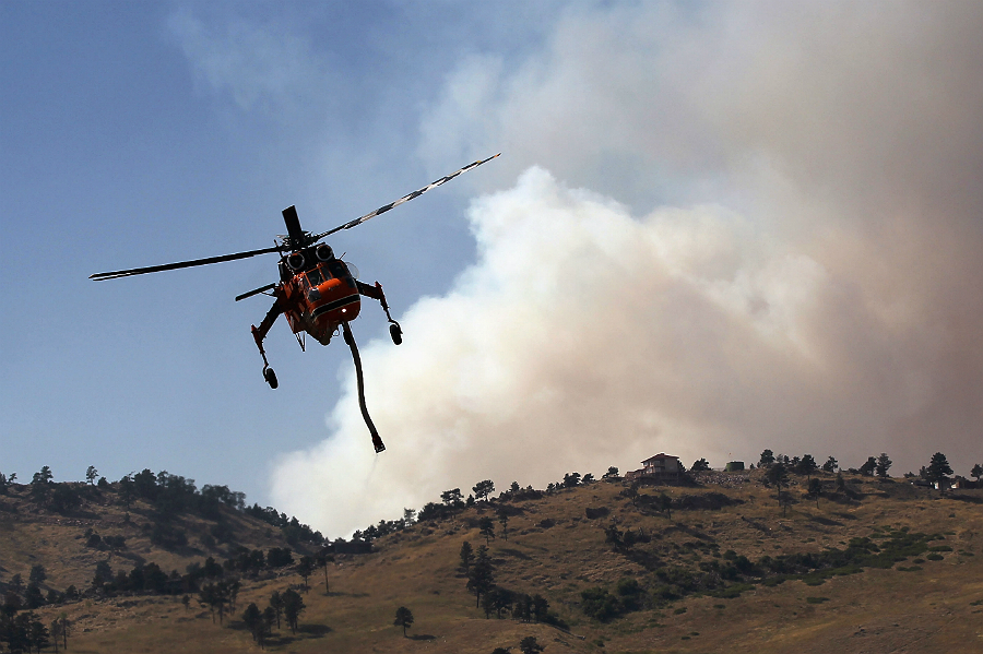 A wildfire near Boulder, Colorado, in 2010 burned more than 160 homes in the first 12 hours and led to losses in the millions of dollars. Credit: John Moore/Getty ImagesA wildfire near Boulder, Colorado, in 2010 burned more than 160 homes in the first 12