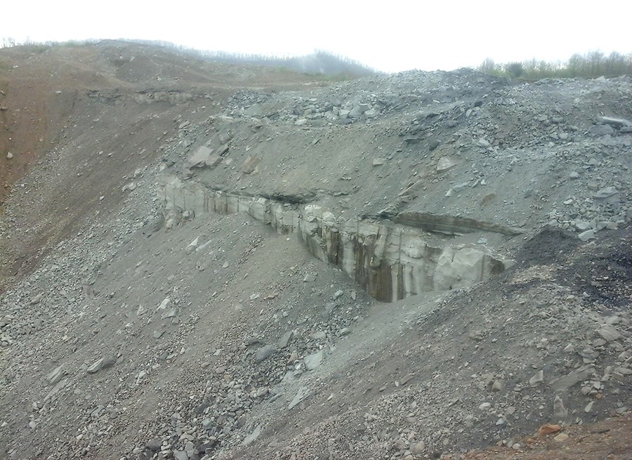 A rock wall still needs to come down as part of the reclamation process. Credit: Kentucky Energy and Environment Cabinet
