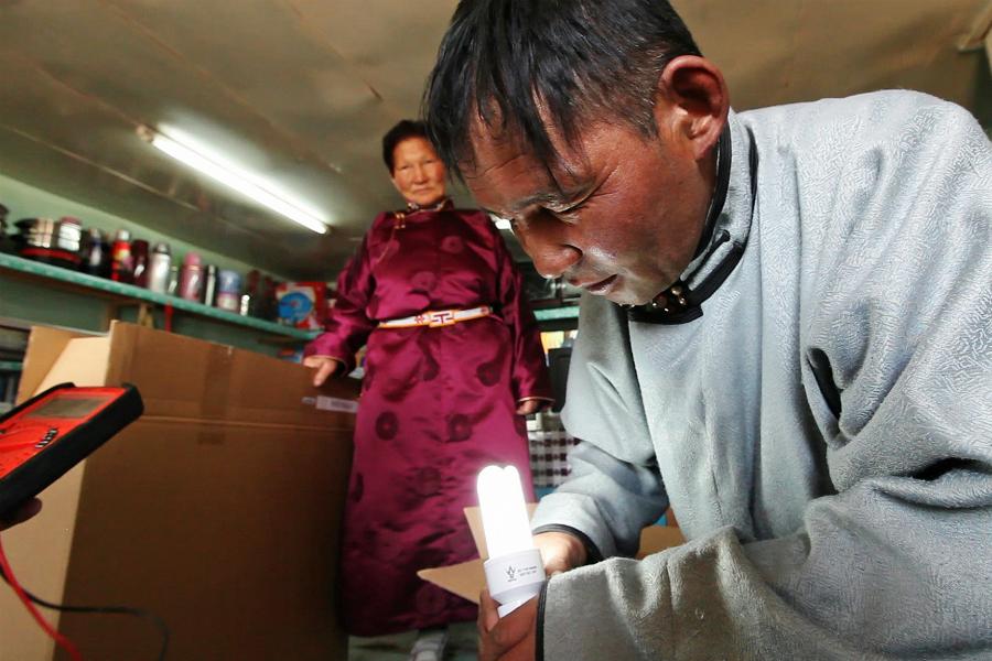 A herder purchases a portable solar power kit in Mongolia. Credit: Stephan Bachenheimer