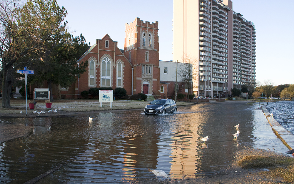 During high tides, the river laps over its walls into the streets of some Norfolk neighborhoods. The Chrysler Museum of Art is just around the corner. Credit: Nicholas Kusnetz/ICN