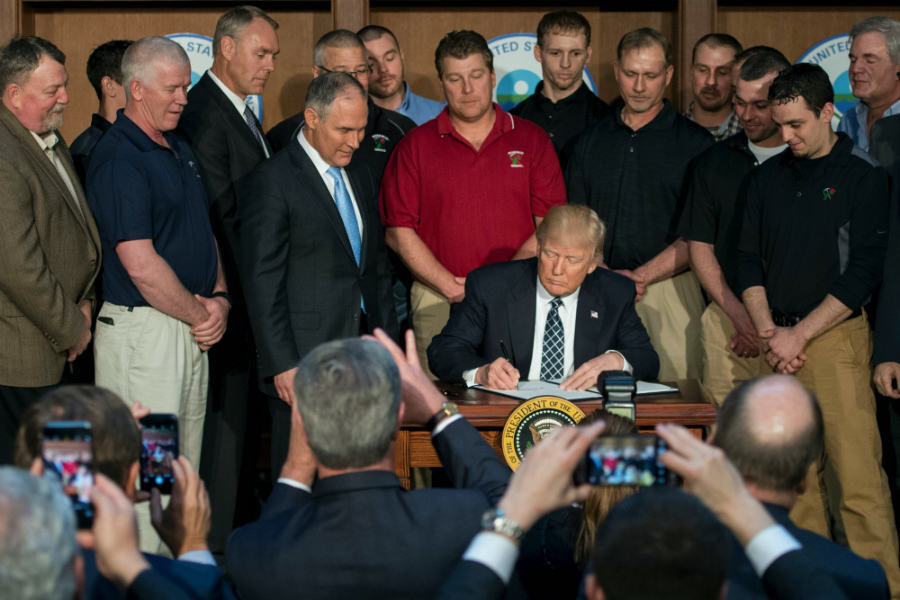 President Trump brought coal mine employees and energy executives to the EPA as his audience when he signed an executive order targeting climate policies in 2017. Credit: Jim Watson/AFP/Getty Images