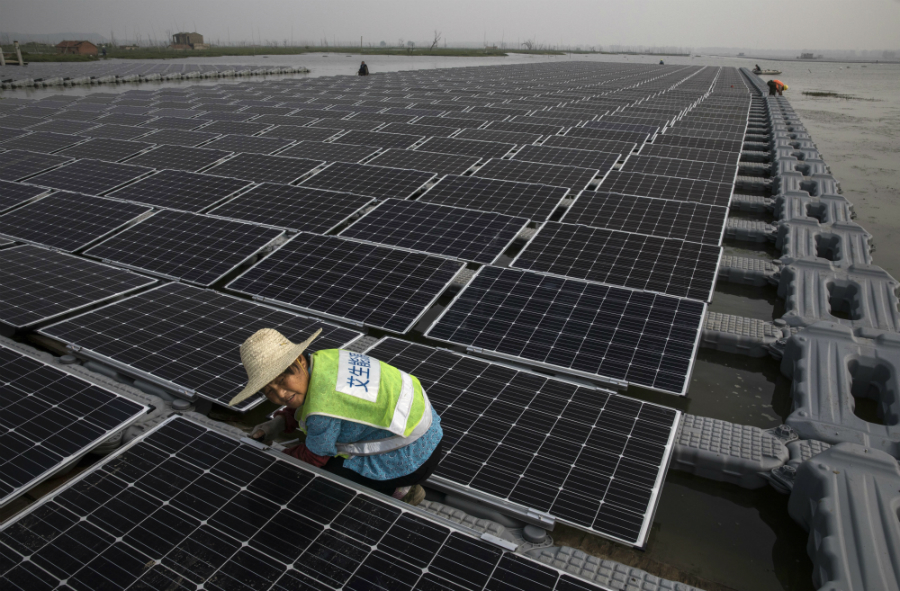 China announced it was scaling back some of its solar subsidies. Analysts expect the policies to reduce the amount of solar installed in China, but increase its solar panel sales globally, lowering prices. Credit: Kevin Frayer/Getty Images